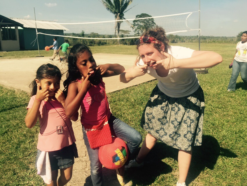 Student playing with local children in Belize (Belize Mission trip, 2015)