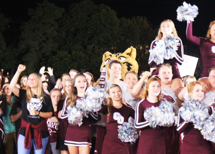 Students, cheerleaders and Bobcat mascot cheering