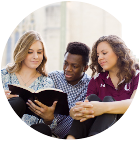 3 students reading the Bible together
