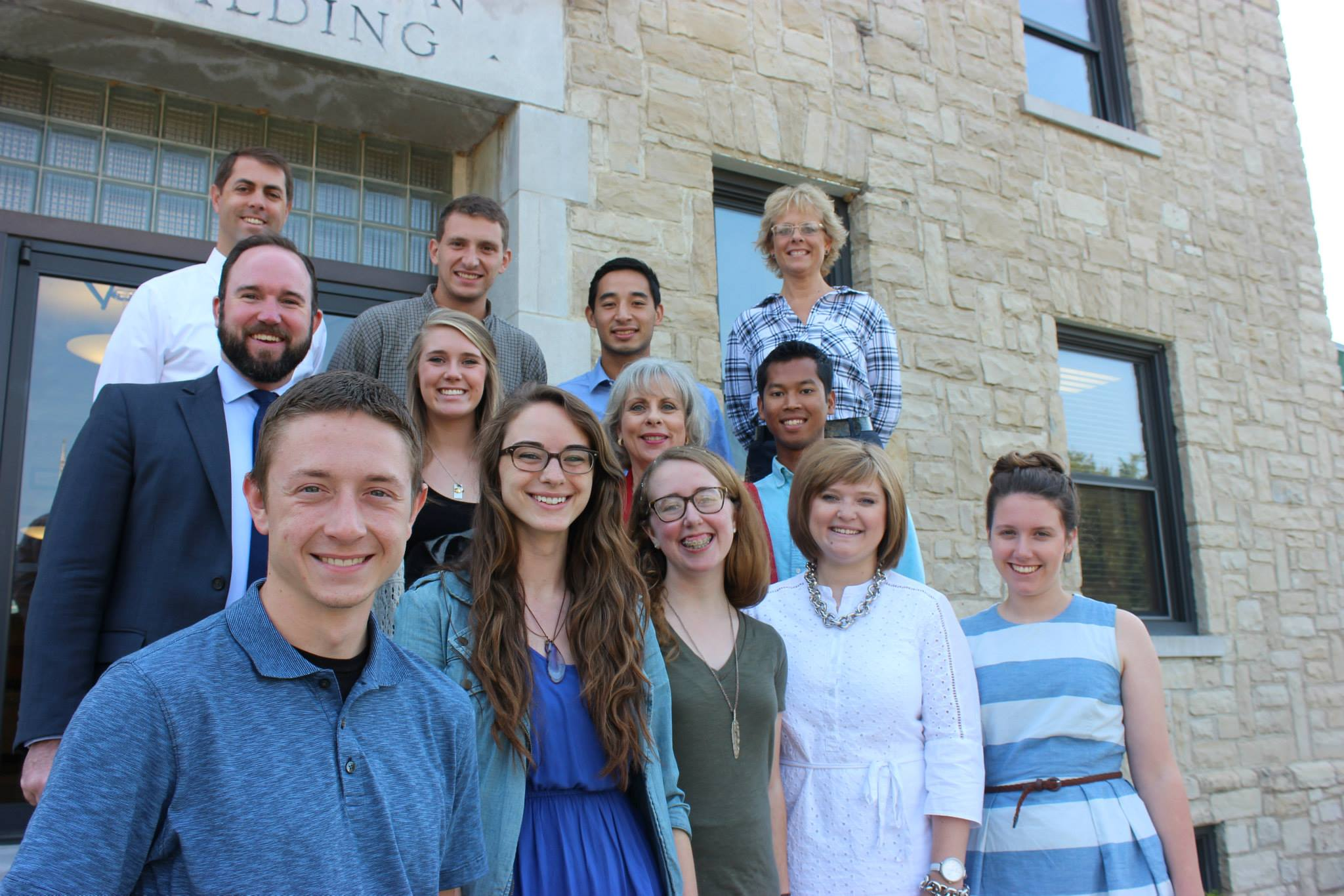 Christian Ministries staff and student workers standing in front of the Christian Ministries building in C of O