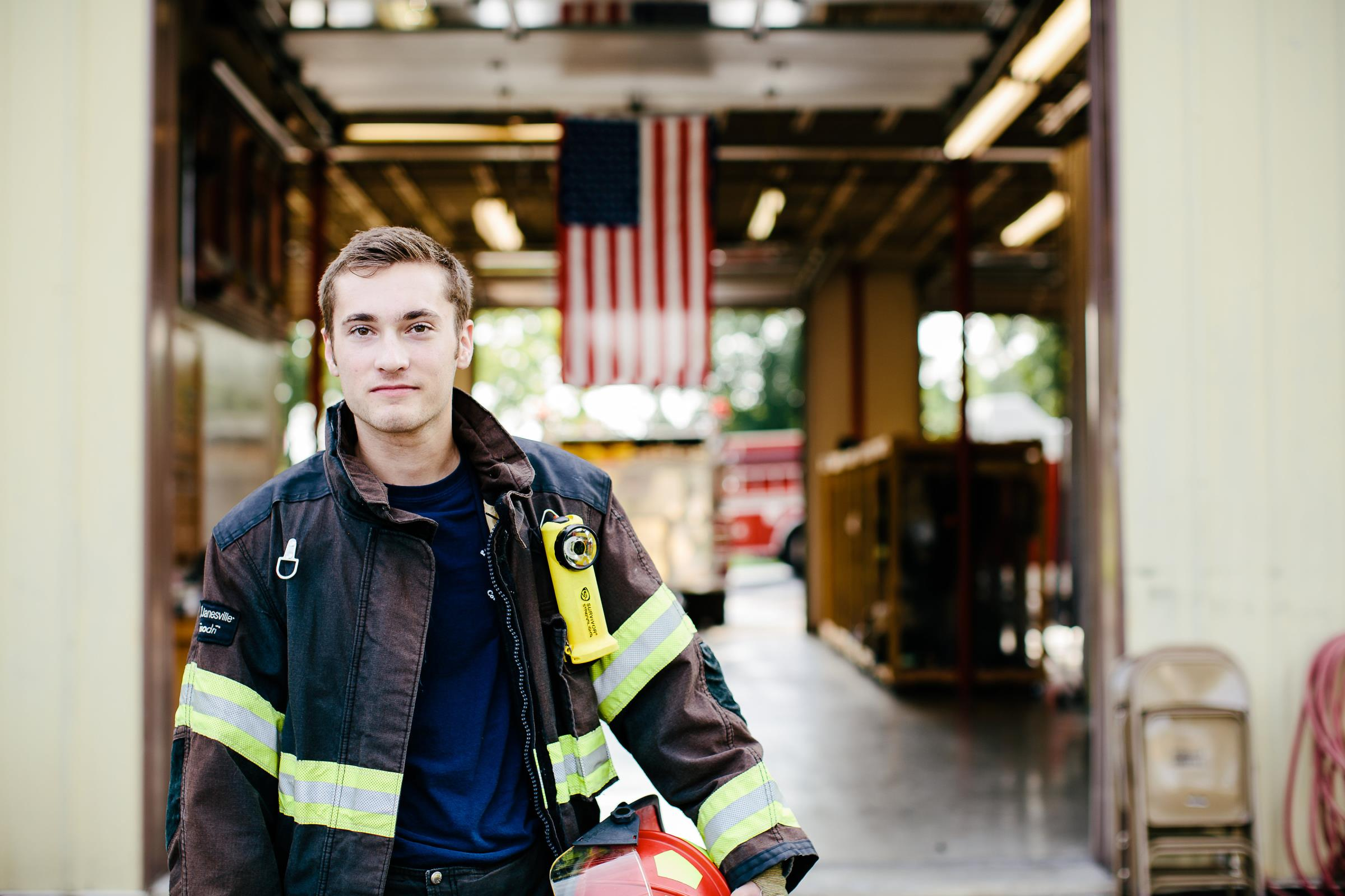 Fire department student worker in front of the firehouse