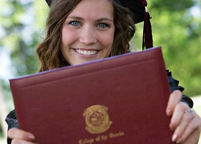 Graduate holding a diploma