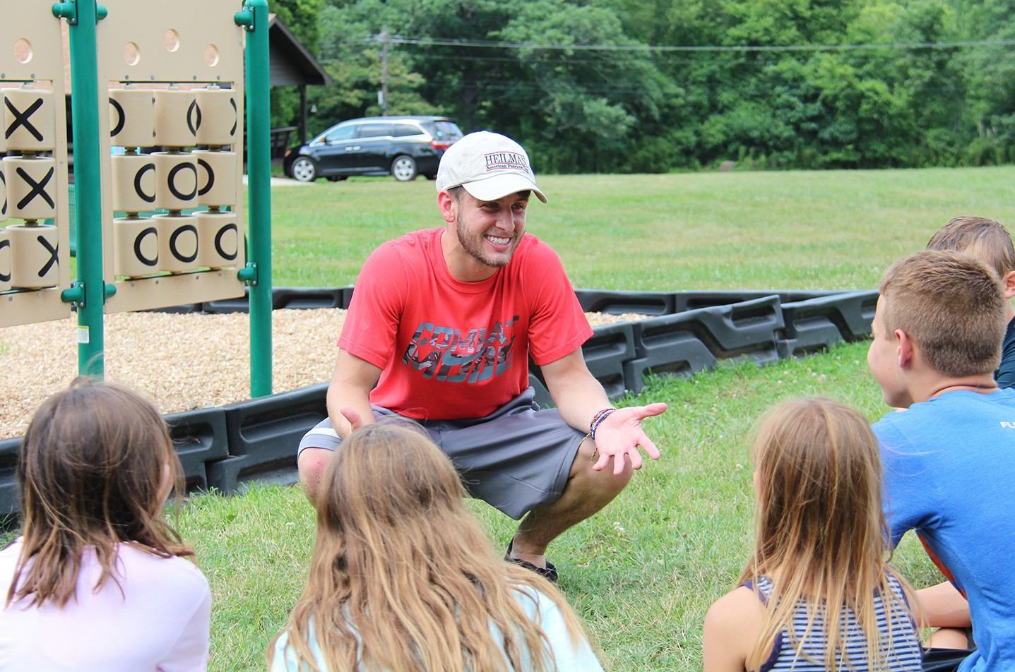 Student ministering to children at Camp Lookout
