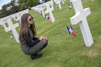 C of O student surveys the gravesites in the Normandy American Cemetery in France.