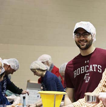 Student, Ben Lunsford, packing meals