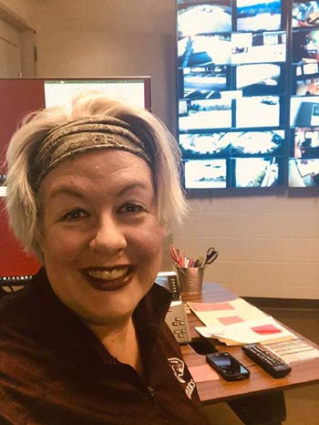 Stacy McNeill, division chair of performing and professional arts, volunteers to answer calls in the switchboard. McNeill has assisted with phone calls to students, crisis communication, and is helping the faculty launch online learning next week.